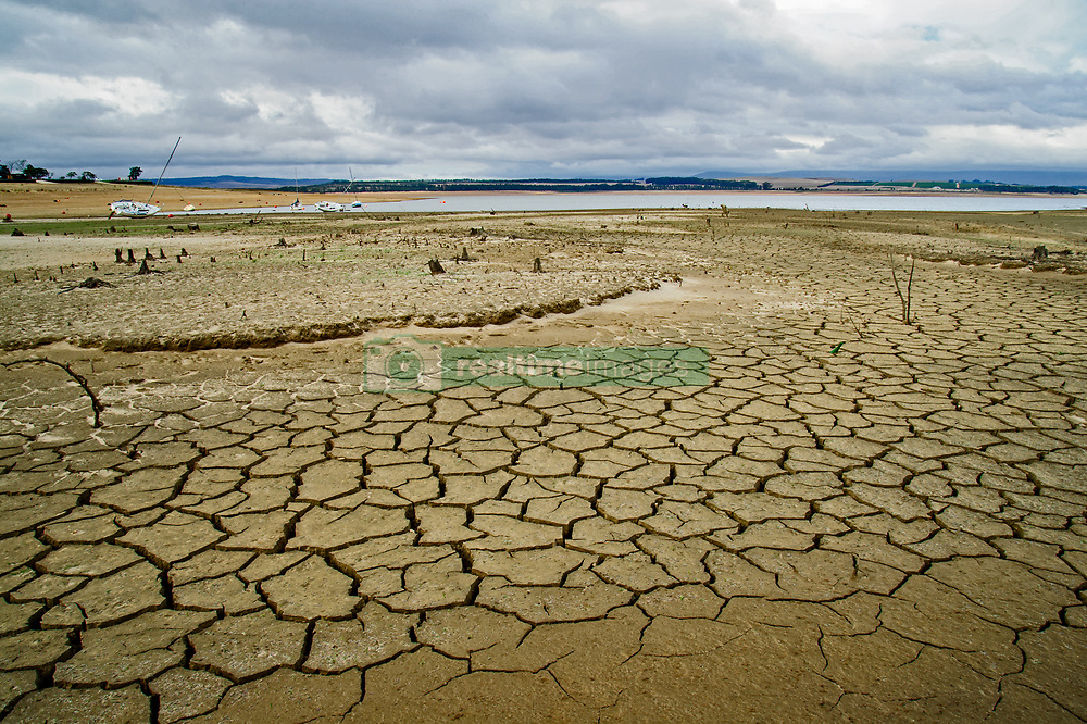 """EXCLUSIVE: SHOCKING IMAGES OF CAPE TOWN'S BONE-DRY DAM WHERE ONCE LOCALS USED TO GO BOATING AND WATER SKIING WITH PIX By Magnus News Agency Shocking images show a bone-dry desert where once boats used to sail on a reservoir as drought continues to ravage South Africa. Theewaterskloof Dam once hosted yacht clubs and water skiing but today not even one vessel could be launched on the parched space. Photographer Dirk Theron visited the starved body of water last week and took these frightening images of the dried-up lake which should supply 40 percent of the water to Cape Town's four million residents. As Dirk's pictures show, skeletons of fish and muddy pools are much of what remains of the former 480 million cubic metre capacity site. Last week billionaire former New York Mayor Michael Bloomberg toured Theewaterskloof as part of his role as UN special Envoy for Climate Action. He warned the reservoir and draught across the Western Cape should act as a wake-up call for the international community on climate change. Despite the drought, which has struck the area for the past few years, government officials in South Africa have been criticised for their handling of the crisis. A 'Day Zero' when municipal taps would be turned off has been pushed back from June 4 to July 9 despite chronic shortages continuing. South African Dirk lives just 30 minutes from Theewaterskloof, but said he was stunned by what he found there. He said: """"Theewaterskloof dam is one of those places where everybody has a boat and people would go there for the weekend. """"A friend of mine used to be a member of the Theewaters sports club, we used to go there all the time water skiing and playing on the water in his boat. """"This was a massive, massive body of water. It's been a few years since last I've been there but when I saw it I was shocked to my core. """"We all know about the water crisis but standing there and seeing it with your own eyes is so surreal. """"I stood on dry ground"""