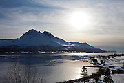 View across Tromso Sound to Tromso and the Lyngen Alps from Kvaloya Island in Arctic Circle Northern Norway