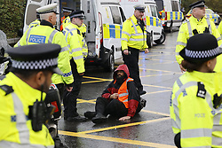 © Licensed to London News Pictures. 27/09/2021. London, UK. One  Insulate Britain climate activist has glued himself to the road as they block a roundabout over the M25 motorway leading to Heathrow airport. Climate activists have vowed to continue their campaign of disruption despite the government being granted a temporary High Court Injucntion banning the group from protesting on the M25. Photo credit: Peter Macdiarmid/LNP