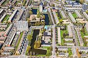 Nederland, Groningen, Groningen, 01-05-2013; De Wijert Noord. Rationele woonwijk uit de wederopbouwperiode. Karakteristieke afwisseling tussen (open) bebouwing en groene ruimtes. De verschillende soorten huizen herhalen zich (herhaalbare module van de wooneenheid ofwel stempels). Lichtblauwe puntdak van de Opstandingskerk centraal op de foto. <br /> New residential area in Groningen built during the period of Reconstruction after World War II . Characteristic alternation between (open) built-up area and green spaces. Rationalistic architecture.<br /> luchtfoto (toeslag op standard tarieven)<br /> aerial photo (additional fee required)<br /> copyright foto/photo Siebe Swart