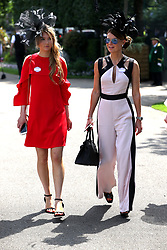 Female racegoers arrive during day two of Royal Ascot at Ascot Racecourse.