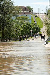 © Licensed to London News Pictures. 09/06/2012. London, UK. The River Rheidol, swollen after two days heavy rain, and with a high tide forcing the waters back, bursts its banks and floods low-lying areas of shops and houses on the outskirts of Aberystwyth Wales UK. Photo credit : Keith Morris/LNP