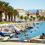 A view of the harbor, Riva (Sea Promenade) and the tower of St. Domnius in Split, Croatia.