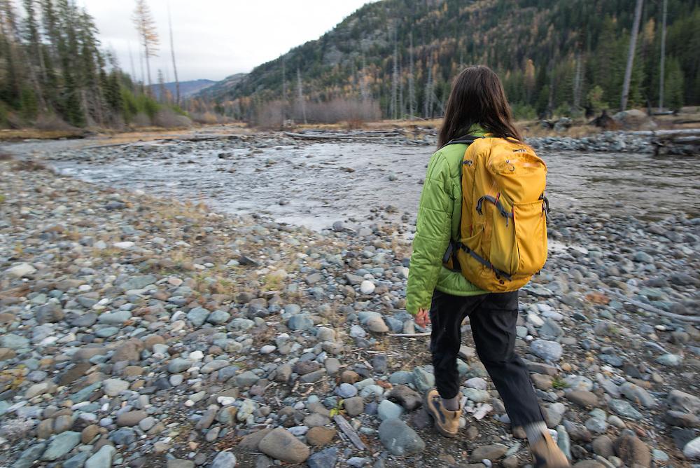 Woman hiking along the Imnaha River in Oregon's Wallowa Mountains.