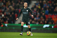 David Silva of Manchester City in action. Premier league match, Stoke City v Manchester City at the Bet365 Stadium in Stoke on Trent, Staffs on Monday 12th March 2018.<br /> pic by Andrew Orchard, Andrew Orchard sports photography.