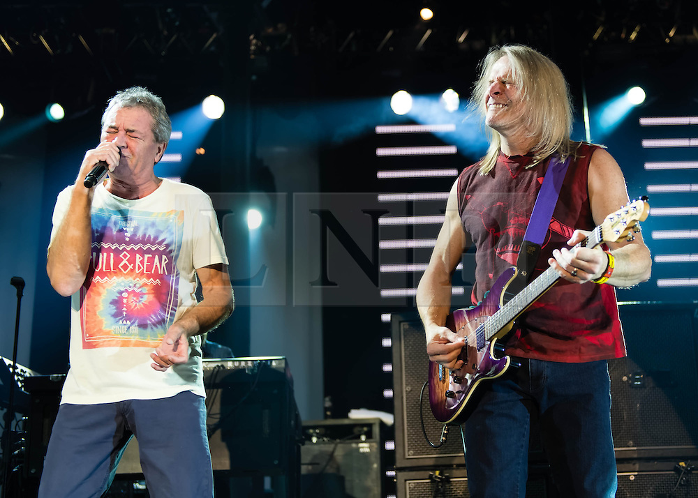 © Licensed to London News Pictures. 16/10/2013. London, UK.   Deep Purple performing live at The Roundhouse. Deep Purple consist of members Ian Paice (drums, percussion),<br /> Roger Glover (bass),Ian Gillan (vocals),Steve Morse (guitar), Don Airey (organ).  In this pic - Ian Gillan (left), Steve Morse (Right).  Photo credit : Richard Isaac/LNP