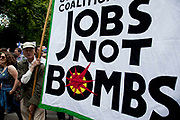 Jobs not bombs banner. Demonstration in Central London on a day of General Strike action by public sector workers and unions. Civil servants, teachers, health workers all came out on a day of peaceful march and protest against government cuts which look set to see their pensions change.