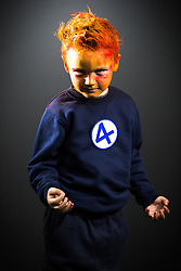 © Licensed to London News Pictures . 26/07/2015 . Manchester , UK . Portrait : HUMAN TORCH ( Max Reeves , five , from Burnley ) at the venue . Comic Con convention at Manchester Central Convention Centre . Photo credit : Joel Goodman/LNP