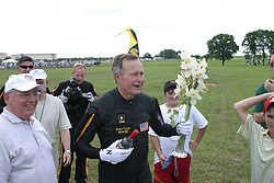 After finishing his parachute jump with the United States Army Golden Knights Parachute Team at the Bush Presidential Library near Houston, Texas on June 13, 2004 to celebrate his his 80th birthday, former President George H.W. Bush is congratulated by former Soviet President Mikhail Gorbachev. Hand out Photo by US Army via CNP /ABACAPRESS.COM