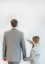 Son showing something to his father