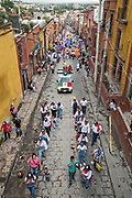 Railroad workers lead a fiesta procession through the city at the start of the week long fiesta of the patron saint Saint Michael September 22, 2017 in San Miguel de Allende, Mexico.