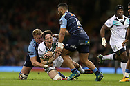 Sam Davies of the Ospreys © is stopped by Gareth Anscombe (l) and Willis Halaholo ® of Cardiff Blues.  Guinness Pro12 rugby match, Judgement day, Cardiff Blues v Ospreys  at the Principality Stadium in Cardiff, South Wales on Saturday 15th April 2017. <br /> pic by Andrew Orchard, Andrew Orchard sports photography.
