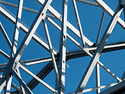 metal construction lattice with blue sky background Photographed in New Orleans