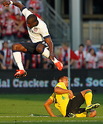United States forward Jozy Altidore, top, jumps to avoid Jamaica defender Adrian Mariappa, bottom, in the first half of a 2014 World Cup qualifier soccer match at Sporting Park in Kansas City, Kan., Friday, Oct. 11, 2013. (AP Photo/Colin E. Braley)
