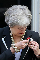 © Licensed to London News Pictures. 25/010/2018. London, UK. Prime Minister Theresa May pins a poppy during the launch of the National Poppy Appeal 2018 outside 10 Downing Street. Photo credit: Dinendra Haria/LNP
