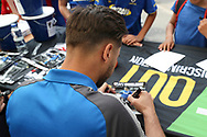 AFC Wimbledon attacker Harry Forrester (11) signing auotgraphs for AFC Wimbledon foundation during the EFL Sky Bet League 1 match between AFC Wimbledon and Oldham Athletic at the Cherry Red Records Stadium, Kingston, England on 21 April 2018. Picture by Matthew Redman.