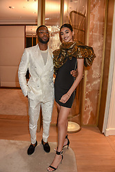 Tinie Tempah and Neelam Gill at the reopening of the Cartier Boutique, New Bond Street, London, England. 31 January 2019. <br /> <br /> ***For fees please contact us prior to publication***