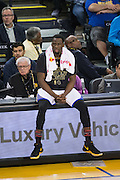 Golden State Warriors forward Draymond Green (23) sits on the media desk during game play against the Charlotte Hornets at Oracle Arena in Oakland, Calif., on February 1, 2017. (Stan Olszewski/Special to S.F. Examiner)