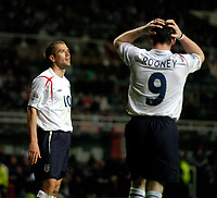 Photo. Jed Wee, Digitalsport<br /> England v Azerbaijan, World Cup Qualifier, 30/03/2005.<br /> England's Michael Owen (L) looks up to the heavens as strike partner Wayne Rooney has his head in his hands as England get increasingly frustrated.