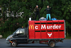 © Licensed to London News Pictures. 15/07/2021. Scunthorpe, UK.  Animal Rebellion activists dance on the roof of a truck outside OSI Food Solutions in Scunthorpe, where they have set up a blockade. The food manufacturing company supply McDonald's restaurants, which Animal Rebellion accuse of mass exploitation of animals and environmental irresponsibility. Photo credit: Adam Vaughan/LNP