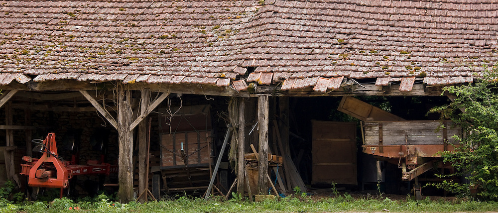 Farm vehicles and barn buildings in the Dordogne, France