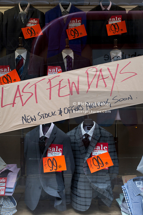 Last few days left of a sale of £99.99 suits plus assorted menswear on Moorgate in the City of London, on 25th March 2019, in London, England.