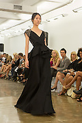 Black gown with peplum top and beaded cap sleeves. By Carmen Marc Valvo at the Spring 2013 Fashion Week show in New York.