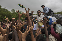 September 19, 2017 - Cox's Bazar, Chittagong, Bangladesh - Rohingya refugees desperately grab food being thrown from trucks by NGO aid workers. Many of the Rohingya fleeing the violence in Myanmar had travelled by boat to find refuge in neighboring Bangladesh. According to United Nations more than 400 thousand Rohingya refugees have fled Myanmar from violence over the last few weeks, most trying to cross the border and reach Bangladesh. (Credit Image: © Can Erok/Depo Photos/zReportage.com via ZUMA Wire)
