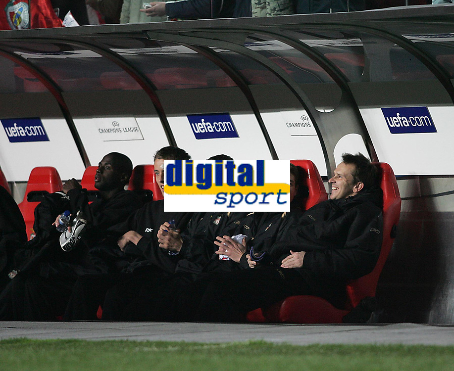 Photo: Lee Earle.<br /> Benfica v Liverpool. UEFA Champions League. 2nd Round, 1st Leg. 21/02/2006. Liverpool's Steven Gerrard (2ndR) started on the bench.