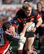 Canterbury reserve halfback Andrew Ellis fends off the tackle of Counties Manukau reserve Grant Henson action during the Air New Zealand Cup week 7 Ranfurly Shield match between Canterbury and Counties Manukau on Sunday September10, 2006 at Jade Stadium in Christchurch, New Zealand. Canterbury won the game 32-16. Photo: Jim Helsel/Photosport