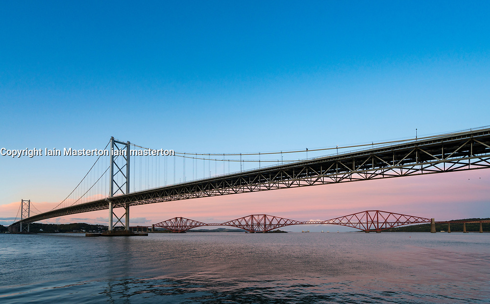 Evening view of Forth Road Bridge and Forth Railway Bridge in Scotland, United Kingdom