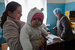 Marina Gubareva brings her young child to an MSF mobile clinic for a checkup in the village of Sukodolsk, near to Lugansk.