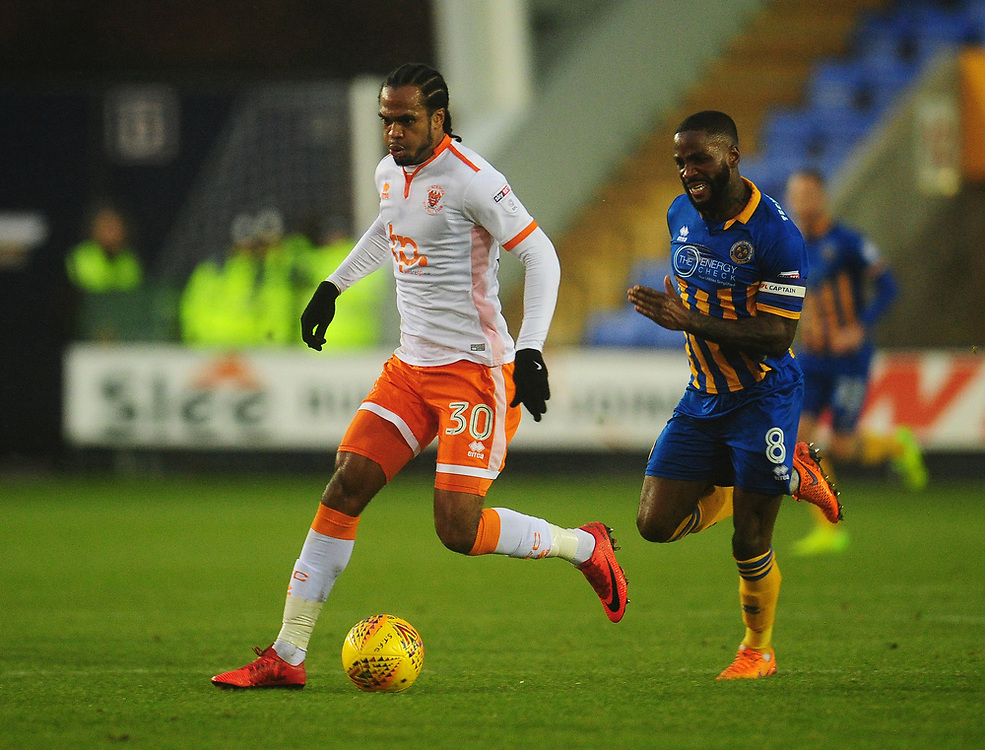Blackpool's Nathan Delfouneso under pressure from Shrewsbury Town's Abu Ogogo<br /> <br /> Photographer Kevin Barnes/CameraSport<br /> <br /> The EFL Sky Bet League One - Shrewsbury Town v Blackpool - Saturday 16th December 2017 - New Meadow - Shrewsbury<br /> <br /> World Copyright © 2017 CameraSport. All rights reserved. 43 Linden Ave. Countesthorpe. Leicester. England. LE8 5PG - Tel: +44 (0) 116 277 4147 - admin@camerasport.com - www.camerasport.com