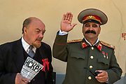 Actors dressed up as Lenin (l) and Stalin rely on tips to make a living in central Moscow.
