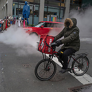 A Grubhub delivery driver on a bicycle delivers food during the holiday season and Coronavirus (Covid-19) outbreak in Manhattan, New York on Tuesday, December 8, 2020. (Alex Menendez via AP)