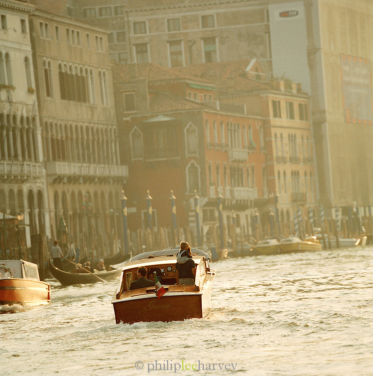 Motor boat driving down the Grand Canal in Venice, Italy