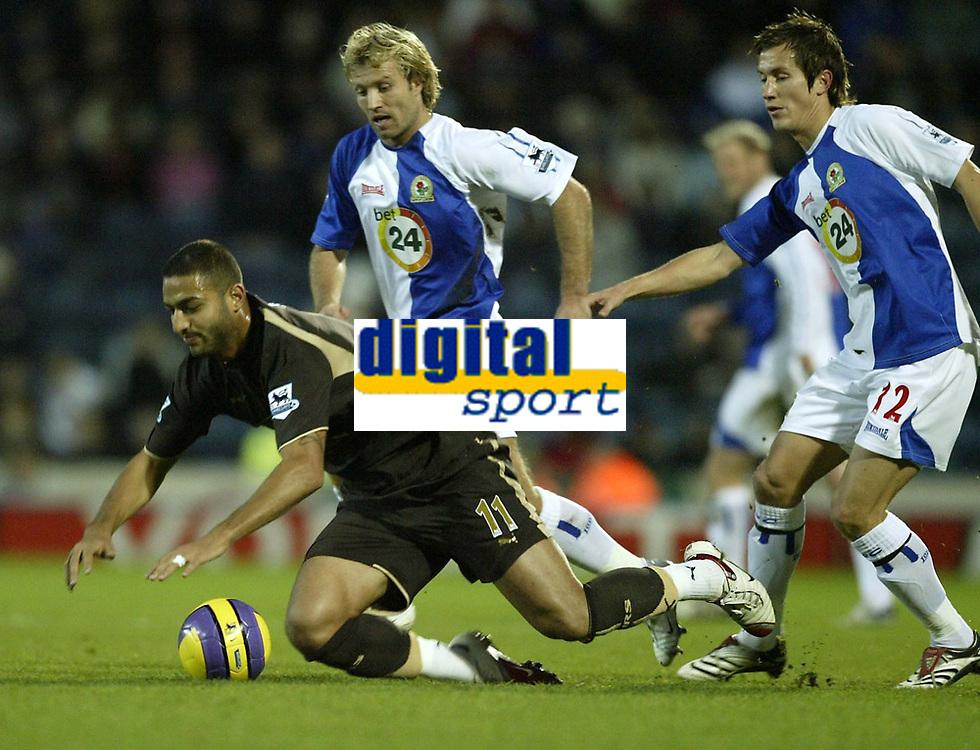 Photo: Aidan Ellis.<br /> Blackburn Rovers v Tottenham Hotspur. The Barclays Premiership. 19/11/2006.<br /> Spurs Mido is brought down by Blackburn's Michael Gray and Morten Gamst Pedersen