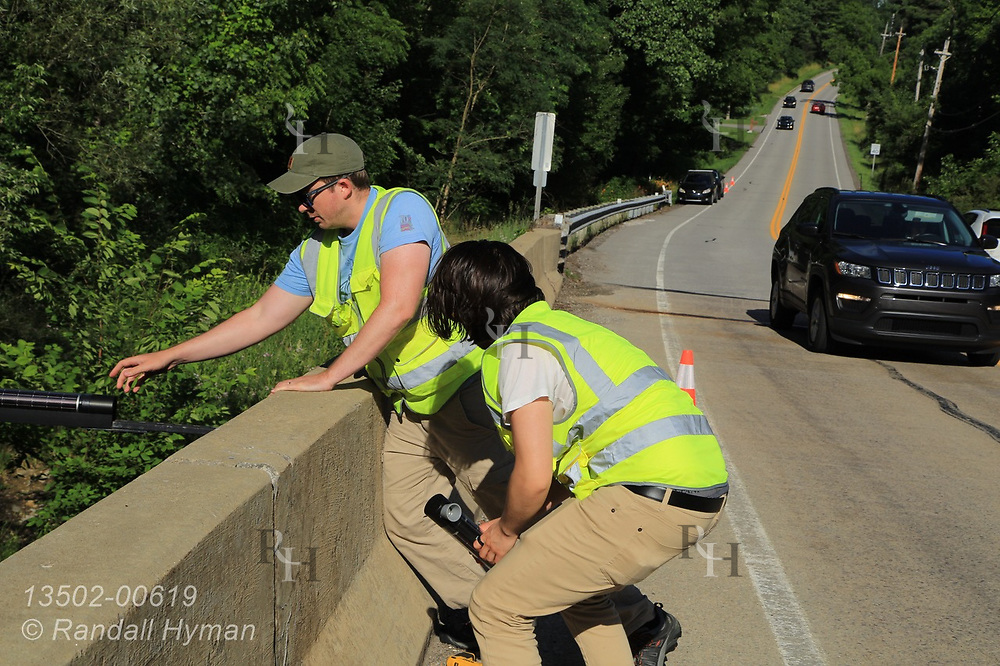 Hyfi CEO Brandon Wong helps field tech Matt Craddock install wireless water-level sensor on bridge over creek feeding the Chagrin River for the Northeast Ohio Regional Sewer District Metro Cleveland, Ohio.