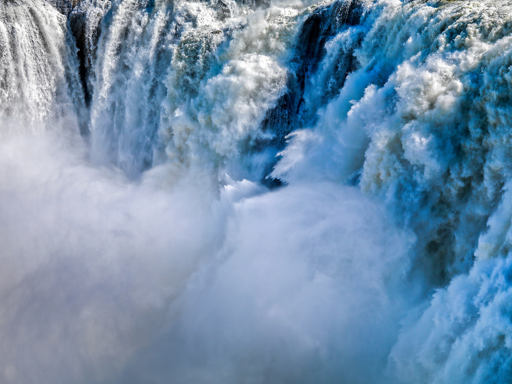 """Shoshone Falls is a waterfall on the Snake River located approximately five miles east of Twin Falls, Idaho. Sometimes called the """"Niagara of the West,"""" Shoshone Falls is 212 feet (64.7 m) high—45 feet (14 m) higher than Niagara Falls—and flows over a rim 1,000 feet (305 m) wide. Shoshone Falls has existed at least since the end of the last ice age, when the Bonneville Flood carved much of the Snake River canyon and surrounding valleys. It is a total barrier to the upstream movement of fish. The falls were the upper limit of sturgeon, and spawning runs of salmon and steelhead could not pass the falls. Yellowstone cutthroat trout lived above the falls in the same ecological niche as Rainbow Trout below it. Due to this marked difference, the World Wide Fund for Nature used Shoshone Falls as the boundary between the Upper Snake and the Columbia Unglaciated freshwater ecoregions. Licensing - Open Edition Prints"""