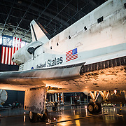 Side view of the Discovery at the Smithsonian Air and Space Museum. The decommissioned Space Shuttle Discovery is on permanent display in the James S. McDonnell Space Hangar at the Smithsonian's National Air and Space Museum's Udvar-Hazy Center in Chantilly, Virginia, just outside Washington DC. The shuttle arrived at the museum on April 19, 2012, and replaces the Space Shuttle Enterprise.