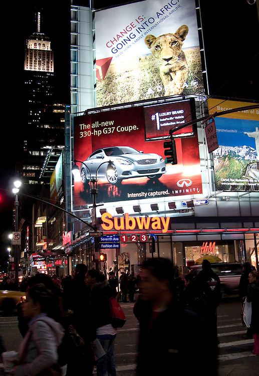 Crowded New York City Streets at night.