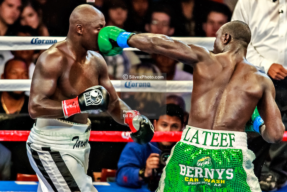 CARSON - JUNE 02: Tarver fights to draw with Kayode at the Home Depot Center. Antonio Tarver (29-6-1) in white trunks  got off to a slow start against the powerful Lateef Kayode (18-0-1) in green trunks, but rallied in the second half of the bout. Tarver and Kayode each won 115-113 on one judge's scorecard, and the third was 114-114 at Home Depot Center. All fees must be ageed prior to publication,.Byline and/or web usage link must read PHOTO Eduardo E. Silva/SILVEX.PHOTOSHELTER.COM Failure to byline correctly will incur double the agreed fee.
