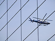 NYPD helicopter inspecting the Brooklyn Bridge against terrorism