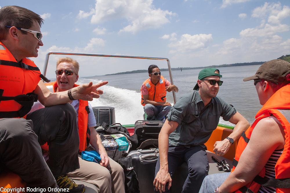 Visitors chat as they ride a speedboat near Balikpapan, East Kalimantan, Indonesia, on March 12, 2016. From left to right are Justin Adams, Global Managing Director for Lands at The Nature Conservancy; Robert Barker, Head of CSR and Sustainable Investment Client Solutions at BNP Paribas; Stephen Donofrio, Senior Advisor for Supply Change at Forest Trends Ecosystem Marketplace; and Fiona Wheatley, Sustainable Development Manager at Marks & Spencer. <br /> (Photo: Rodrigo Ordonez)