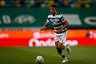 Matheus Nunes conducts the ball during the Liga NOS match between Sporting Lisbon and Belenenses SAD at Estadio Jose Alvalade, Lisbon, Portugal on 21 April 2021.