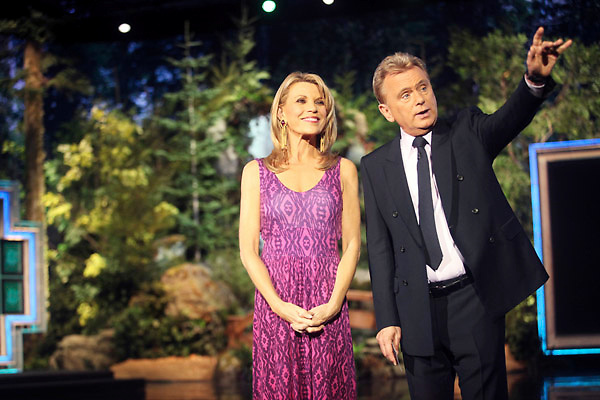 Hosts Vanna White and Pat Sajak greet the studio audience during a taping of the Wheel of Fortune television show at the Oregon Convention Center in Portland on Monday, April 2, 2012.
