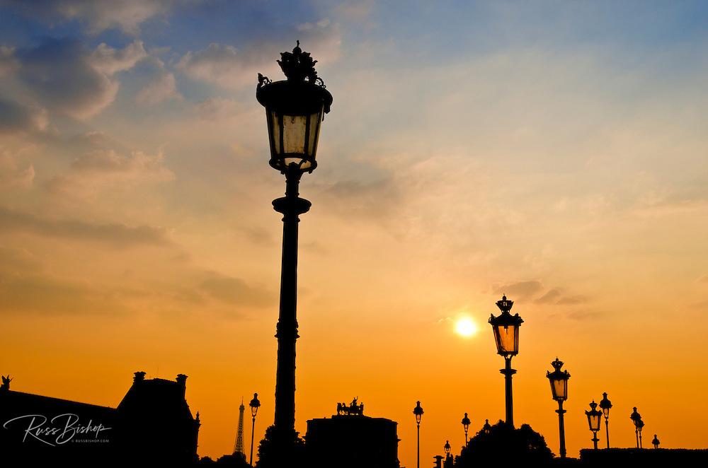 Street lamps at sunset, Louvre Museum, Paris, France