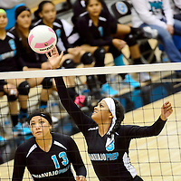 111413  Adron Gardner/Independent<br /> <br /> Navajo Prep Eagle Keona Leano (13), left, watches as Eagle Jasmine Coleman (3) tips to the Cuba Rams during the state volleyball tournament at Cleveland High School in Rio Rancho Thursday.  The Eagles beat the Rams in three sets to advance in the tournament.