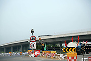 A statue of a policeman stands and cautions drivers near a construction site on a highway in Yangzhou, Jiangsu Province, China on 19 July 2012. China has one of the highest road fatality rates in the world as well as the fastest growing automobile market in the world, as most of the drivers are relatively inexperienced.