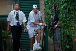 LONDON, ENGLAND - Wednesday, June 23, 2010: John Isner (USA) pulls himself up the stairs as he returns from a toilet break during his record-breaking marathon Gentlemen's Singles 1st Round match, which ended due to bad light at 59-59 in the fifth set, on day three of the Wimbledon Lawn Tennis Championships at the All England Lawn Tennis and Croquet Club. (Pic by David Rawcliffe/Propaganda)
